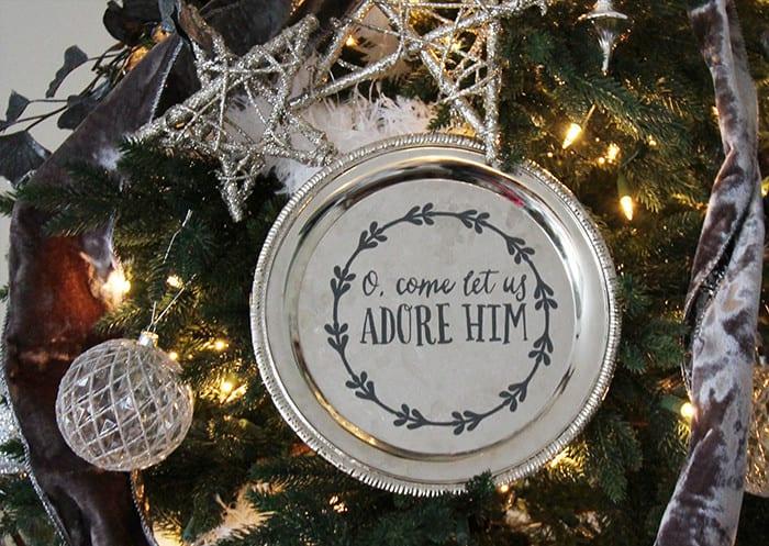 Vinyl on a serving platter used as a Christmas Tree ornament. Cricut Christmas ornaments.