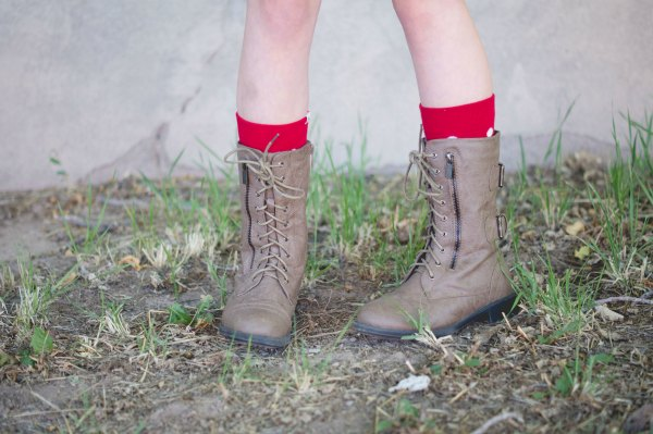 Ways to add personality to a school uniform. Style an outfit with cute boots.