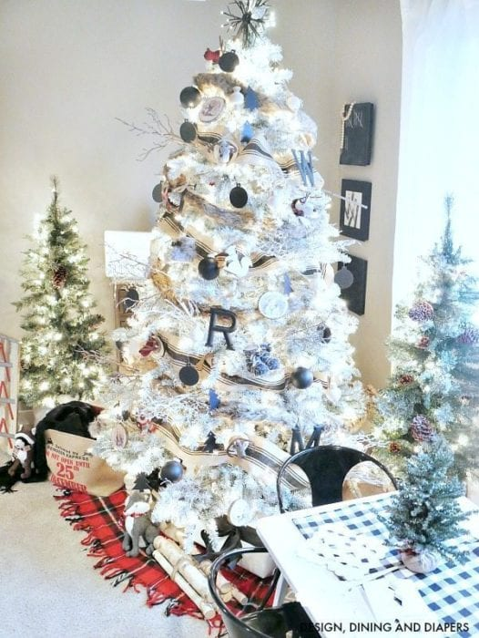 taryn whitaker decorated her white christmas tree with a woodland theme i love the burlap ribbon fur ornaments and wooden touches see the details and - Black And White Christmas